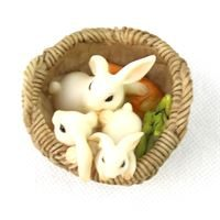 fairy garden accessories: three bunnies in a basket