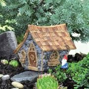 6cm high resin Crooked Cottage for use in a miniature fairy garden